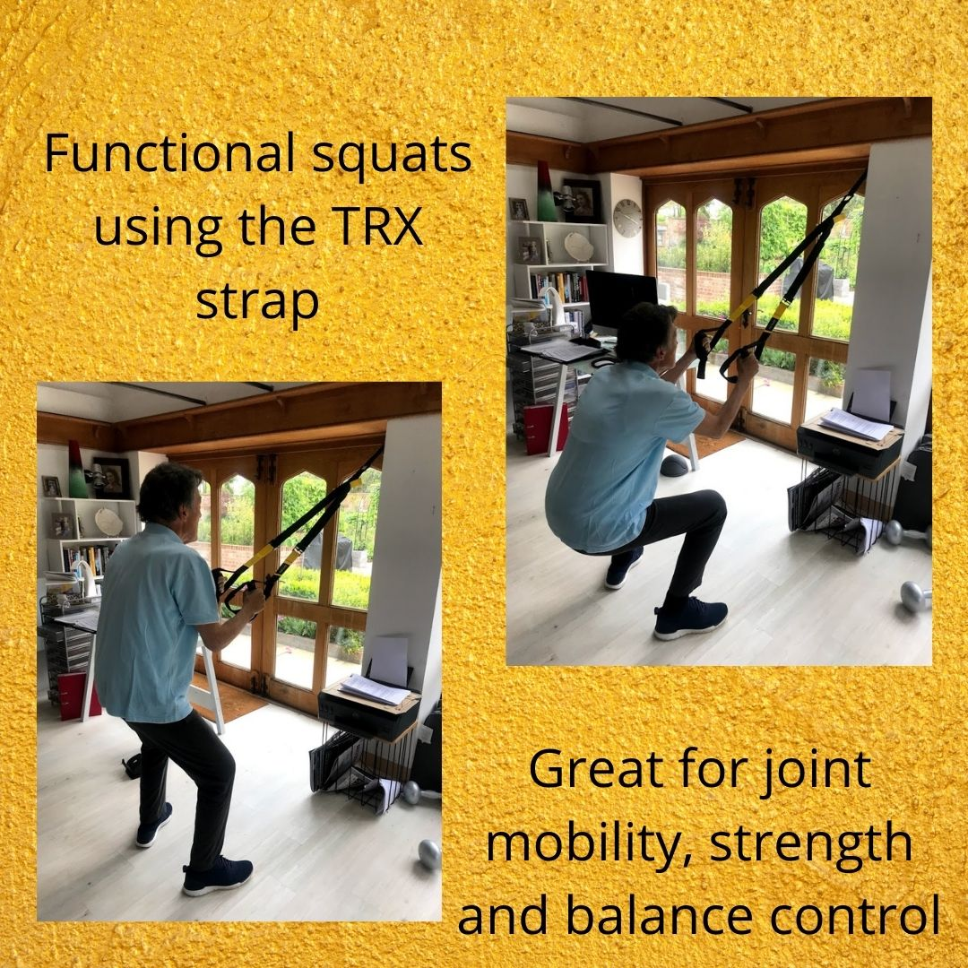 Functional squats using the TRX strap